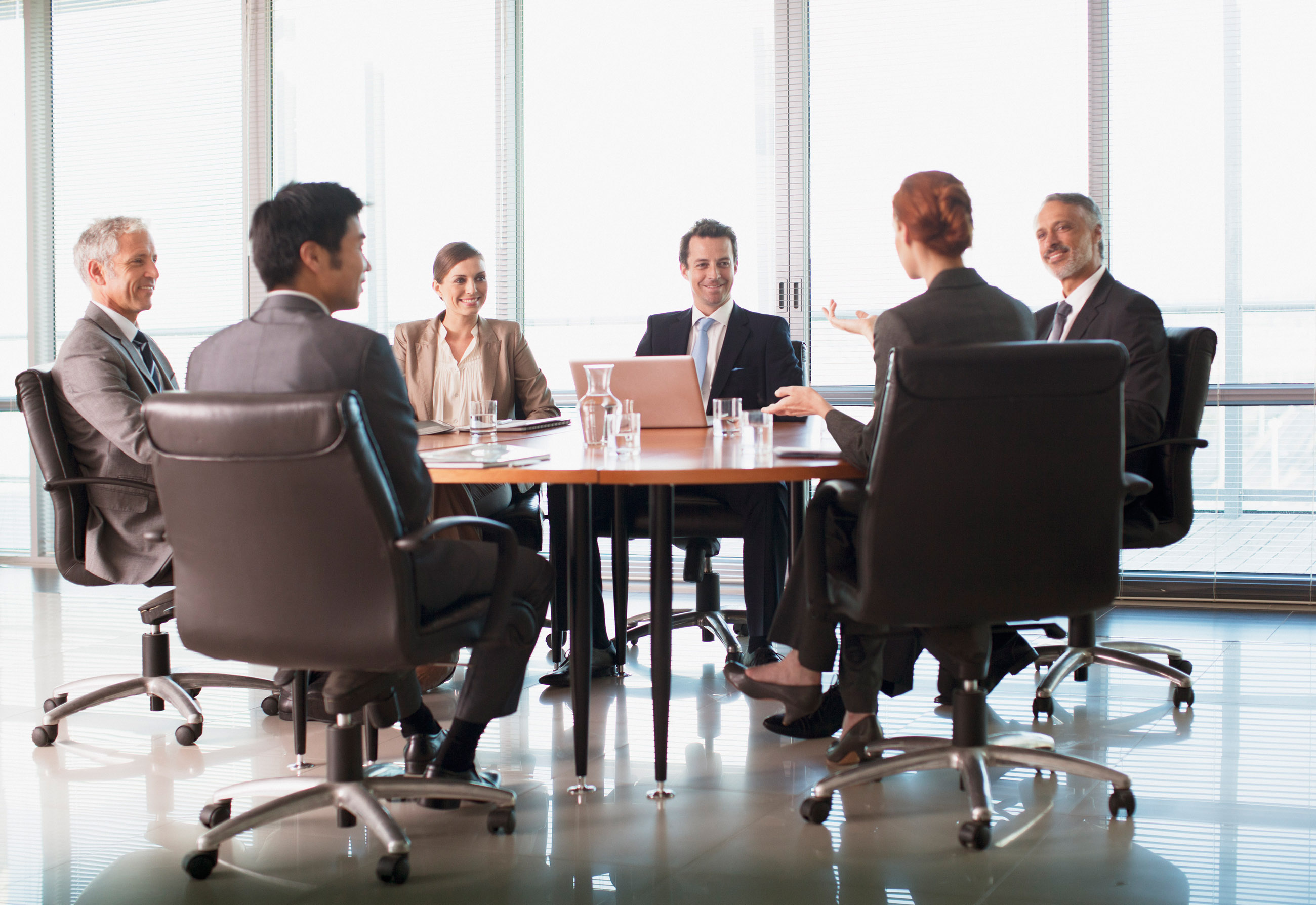 Superbe Business People Meeting At Table In Conference Room